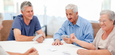 Residents and visitors playing cards